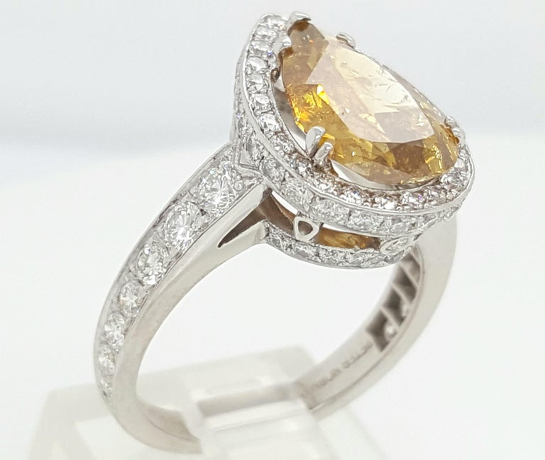 GIA Certified 2.12 Carat Fancy Yellow Pear Diamond Ring In New Condition For Sale In Addison, TX