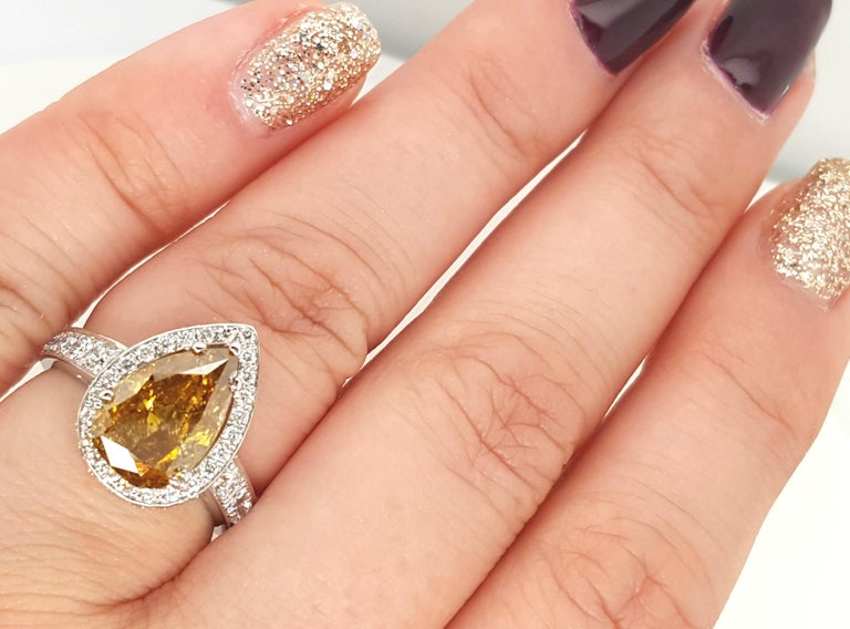 Women's GIA Certified 2.12 Carat Fancy Yellow Pear Diamond Ring For Sale