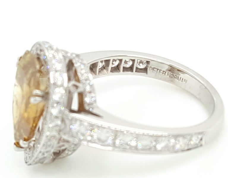 GIA Certified 2.12 Carat Fancy Yellow Pear Diamond Ring For Sale 2