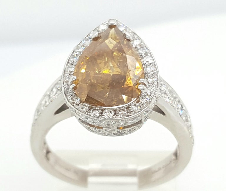 GIA Certified 2.12 Carat Fancy Yellow Pear Diamond Ring For Sale 3