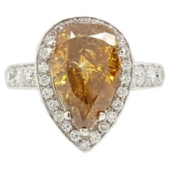 GIA Certified 2.12 Carat Fancy Yellow Pear Diamond Ring