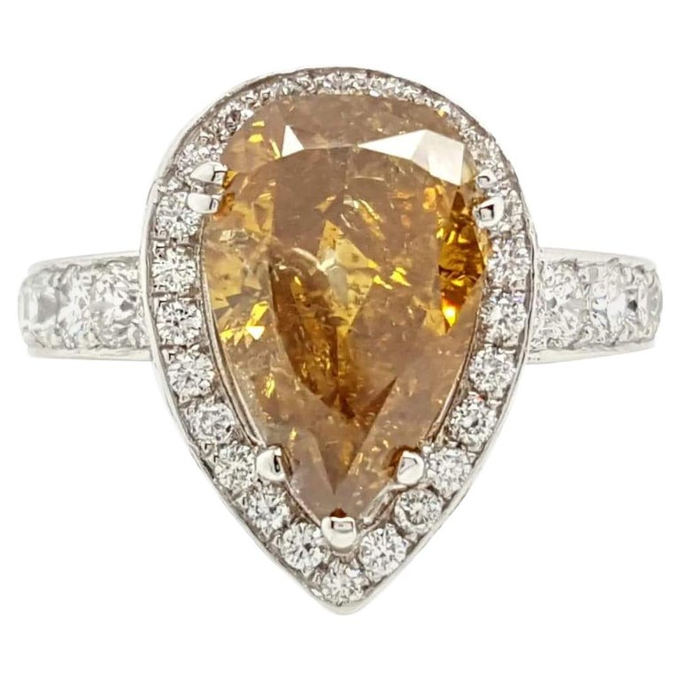 GIA Certified 2.12 Carat Fancy Yellow Pear Diamond Ring For Sale