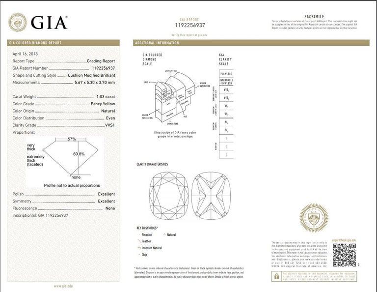 18K White gold fancy yellow diamond stud earrings with two GIA Certified Cushion Cut Diamonds.  - Center diamonds totaling 2.10 Carats Fancy Light Yellow Cushion Cut Diamonds, SI in Clarity  - GIA#1192256937 ; 1192264192 - Diamonds around totaling