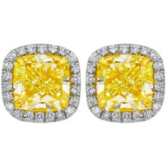 GIA Certified 2.19 Carat Yellow Diamond Stud Earrings