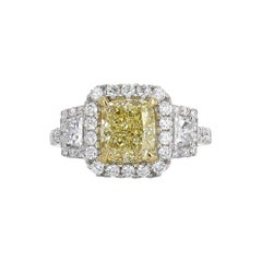 GIA Certified, 2.20 Carat Fancy Light Yellow Diamond Ring