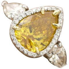 GIA Certified 2.20 Carat Pear Brilliant Vivid Yellow-Orange Diamond 3-Stone Ring