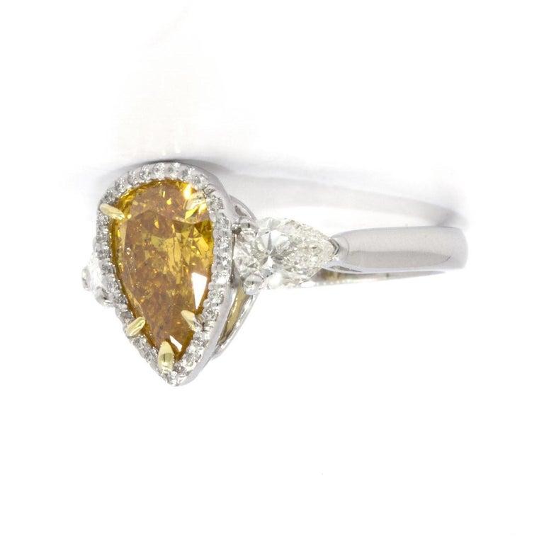 Contemporary GIA Certified 2.20 Carat Vivid Yellow-Orange Pear Shape Diamond Ring For Sale