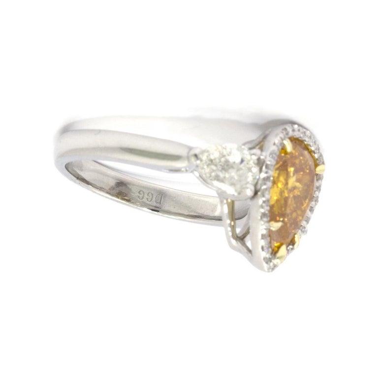 Pear Cut GIA Certified 2.20 Carat Vivid Yellow-Orange Pear Shape Diamond Ring For Sale