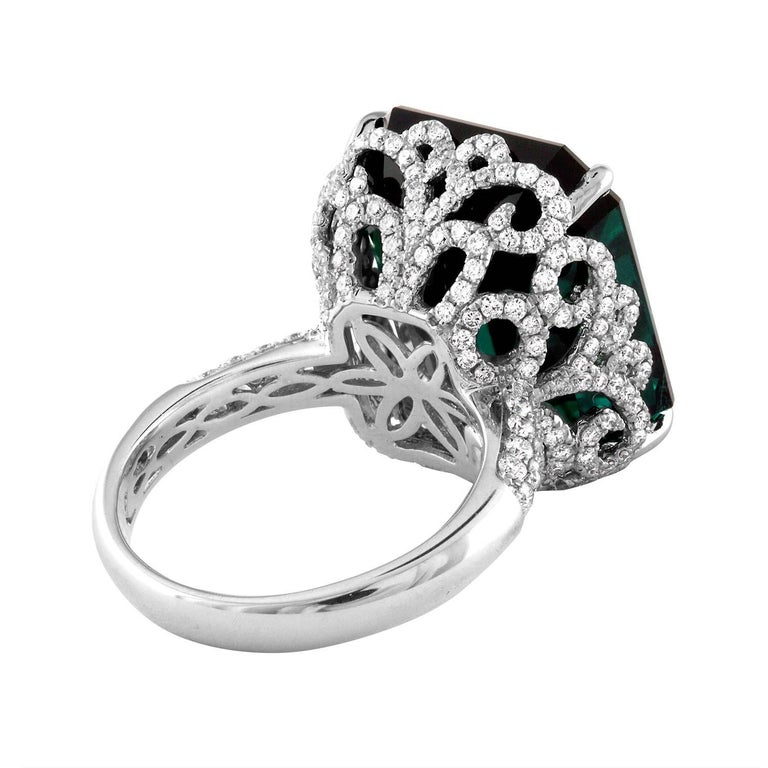 Stunning Tourmaline Ring The ring is 18K White Gold The center is 22.17 Carats Dark Bluish Tourmaline The Tourmaline is GIA Certified No Heat There are 1.22 Carats in Diamonds F/G VS/SI The ring is a size 6.5, sizable. The ring weighs 10.6 grams.