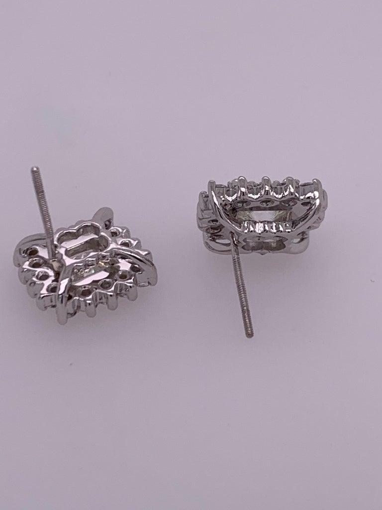 GIA Certified 2.23 Carat Natural Cushion Cut Pair J-K VS2 Diamond Gold Earrings For Sale 4