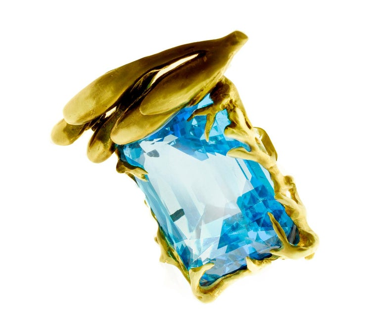 The center of this 18 Karat yellow gold Fairy Tale cocktail ring is GIA Certified 22.59 Carats aquamarine. The dimension of the gem: 8.72 x 16.31 x 11.49 mm.   This ring is designed by the artist Polya Medvedeva, who's mission for the last 10 years