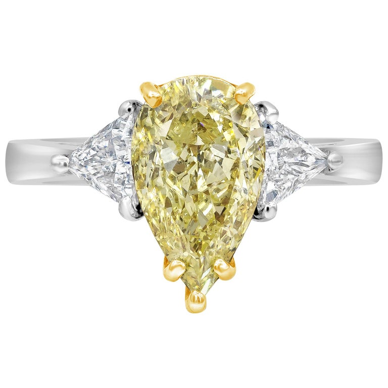 GIA Certified 2.45 Carat Pear Shape Yellow Diamond Three-Stone Engagement Ring For Sale