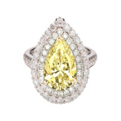 GIA Certified 2.50 Carat Double Prong Fancy Yellow Diamond Platinum Ring