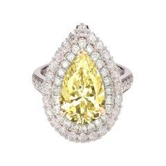 GIA Certified 2.50 Carat Double Prong Fancy Yellow Diamond Platinum Ring