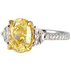 GIA Certified 2.50 Carat Oval Cut Natural Fancy Light Yellow Diamond Ring