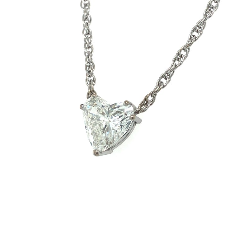 This beautiful solitaire necklace by Swiss jeweller Bucherer features a 2.54 carat heart-shaped diamond of I colour and i1 clarity. Custom made and handcrafted prong setting in 18 karat white gold, mounted on a fine Prince of Wales chain (rope