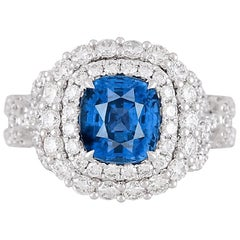 GIA Certified 2.55 Carat Cushion Cut Ceylon Sapphire and Diamond Halo Ring
