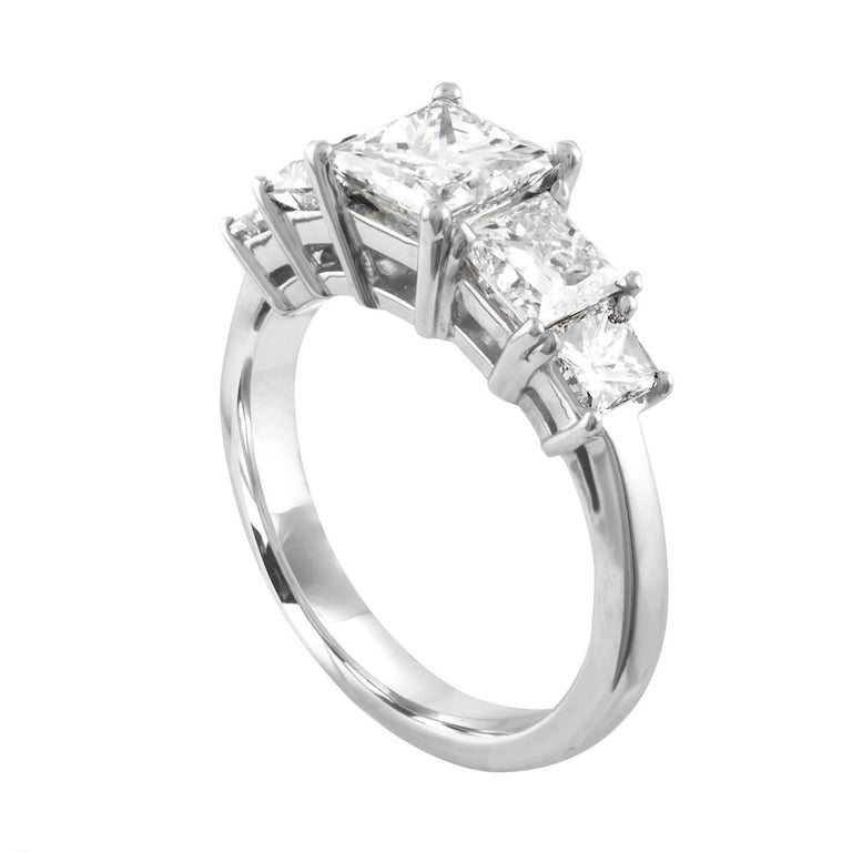 Classically Stunning Five Stone Ring The ring is Platinum There are 5 Princess Cut Diamonds All GIA Certified Stones The center is Carat 1.05 J VS1 Princess Cut Diamond The side is Carats 0.53 J VVS2 and 0.54 J VVS2 The far side is Carats 0.20 G VS1