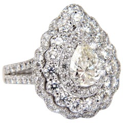 GIA Certified 2.62ct Pear Shape diamond Ballerina ring 14kt. cluster H/Vs1