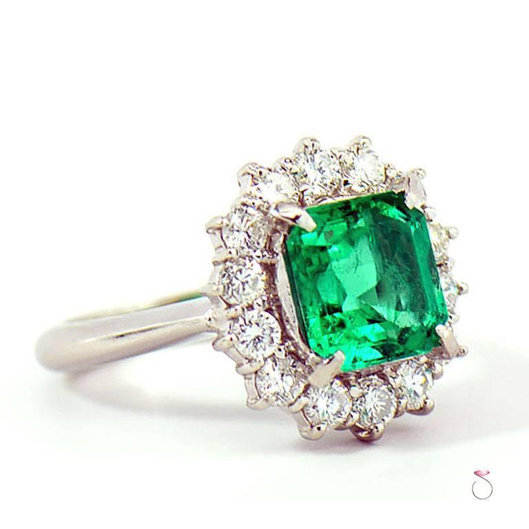Natural Colombian Emerald & Diamond Halo ring is just stunning. The ring features a 2.64 carat natural square Emerald  cut in the center Surrounded by a beautiful diamond halo. The 2.64 carat center Colombian Green Emerald is accompanied by GIA