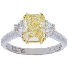 GIA Certified 2.67 Carat Fancy Yellow Radiant Diamond Three Stone Ring