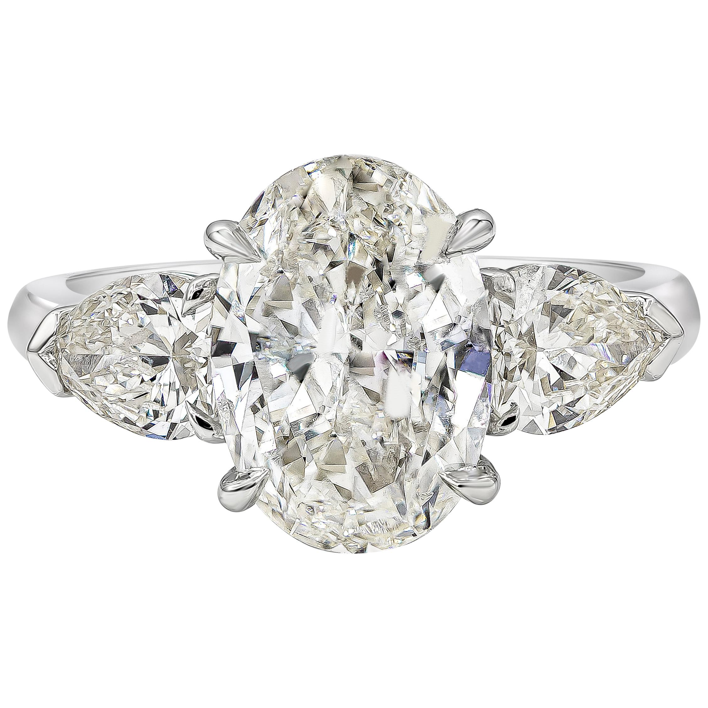 GIA Certified 2.71 Carat Oval Diamond Three-Stone Engagement Ring