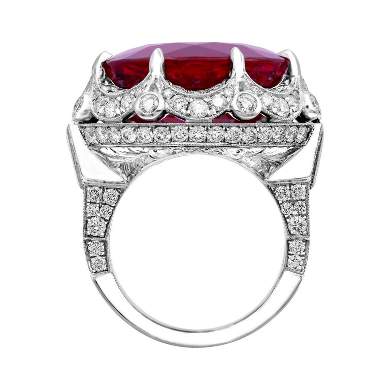 A Rear Vintage find! This Platinum 27.25ct ound Red Rubellite Tourmaline Diamond Ring is truly Gorgeous and one of a kind!  Bright Red Rubellite Tourmaline Color is captivating, extremely bright and vibrant Diamond setting performed in a ArtDeco