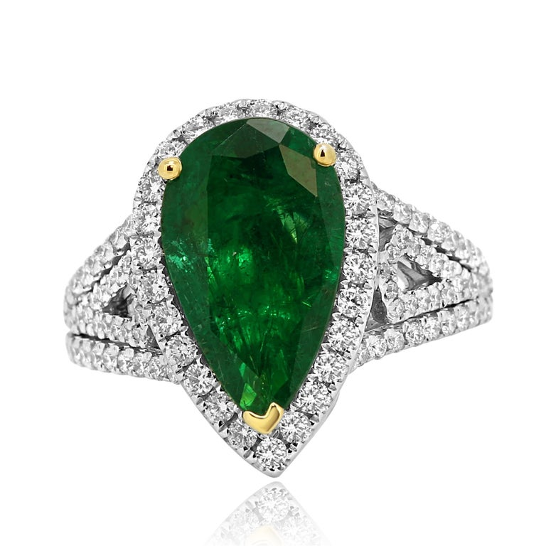 Stunning GIA Certified  2.79 Carat Emerald Pear Shape Encircled in a Halo of White Round Diamond 0.75 Carat in Gorgeous 14K White and Yellow Gold Bridal as Well as Cocktail Ring.  Style available in different price ranges. Prices are based on your
