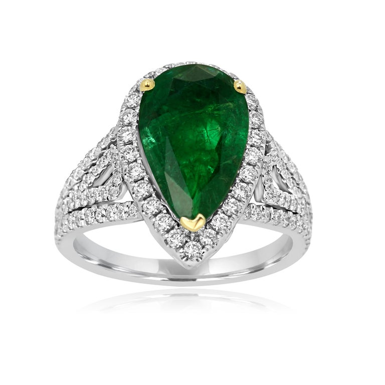 Contemporary GIA Certified 2.79 Carat Emerald Pear Diamond Halo Two-Color Gold Ring For Sale