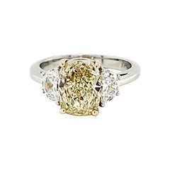 GIA Certified 2.80 Carat Fancy Yellow Cushion Cut Diamond Three-Stone Ring