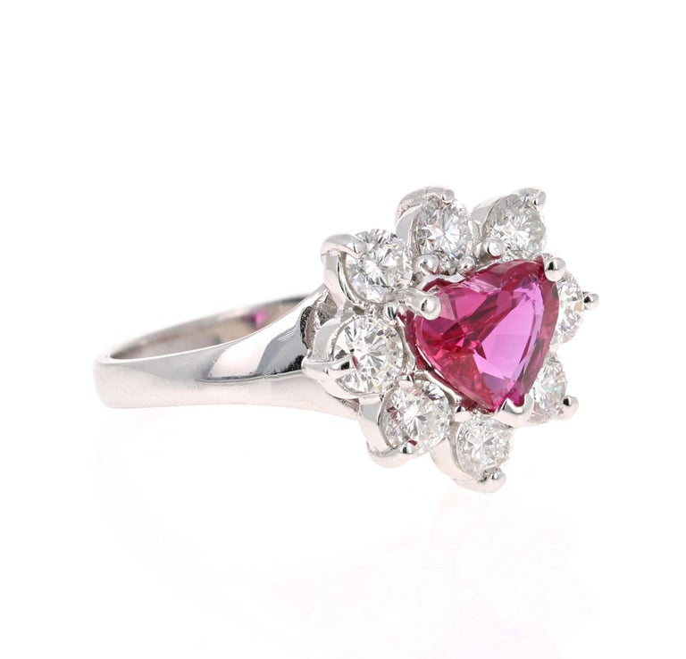 This ring has a stunning Heart Cut GIA Certified Ruby that weighs 1.72 carats.  There are 8 Round Cut Diamonds that weigh 1.17 Carats                    (Clarity: SI Color: F)  The total carat weight of the ring is 2.89 Carats.   This ring is casted