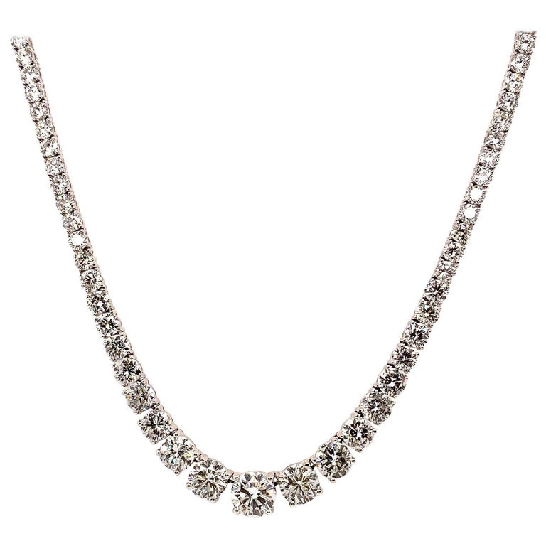 Incredible necklace from ISSAC NUSSBAUM NEW YORK. This exquisite riviera necklace in a graduated setting, crafted in handmade 18k gold features perfectly cut ideal round brilliant diamonds. Center stone is a 2 carat stunner which graduates down to