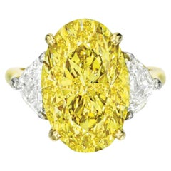 GIA Certified 3 Carat Long Oval Fancy Vivid Yellow Diamond Ring