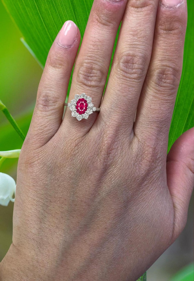 This spectacular oval ruby engagement ring features a magnificent, 2 carat pure red ruby. This world class gem is a beautifully symmetrical oval with ideal color and exceptional brilliance and life.   It is accompanied by Gemological Institute of