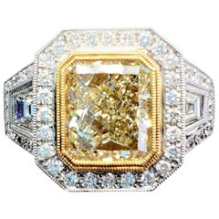 GIA Certified, 3-Stone Natural Yellow Diamond and White Diamond Fashion Ring