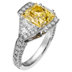 GIA Certified 3-Stone Ring with 4.01 Carat Fancy Light Yellow Diamond