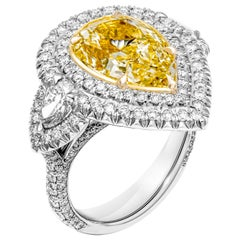 GIA Certified 3-Stone Ring with 5.27 Carat Fancy Light Yellow VS2 Pear Shape