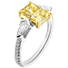 GIA Certified 3-Stone with 2.50 Carat Fancy Light Yellow VS1 Radiant Diamond