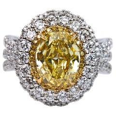 GIA Certified 3.01 Carat Fancy Intense Yellow Oval Cut Diamond Ring