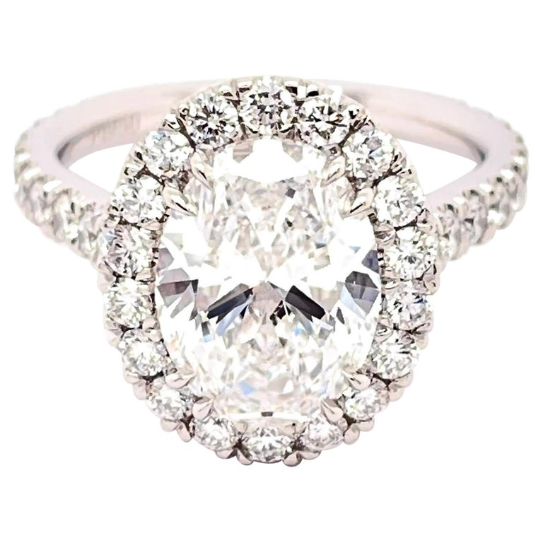 GIA Certified 3.01 Carat Oval Diamond Engagement Ring For Sale