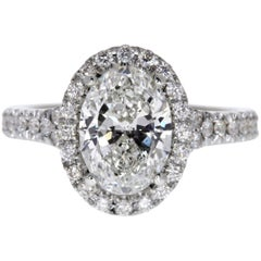 GIA Certified 3.01 Carat Oval Diamond Solitaire Halo Ring in 14 Karat White Gold