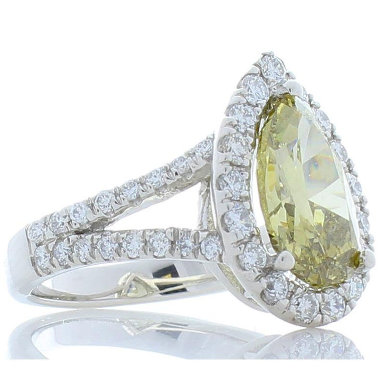 Contemporary GIA Certified 3.01 Carat Pear Shape Fancy Yellow Diamond Cocktail Ring In Plat For Sale