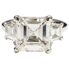 GIA Certified 3.01 Carat Square Emerald Cut Diamond Platinum Three-Stone Ring