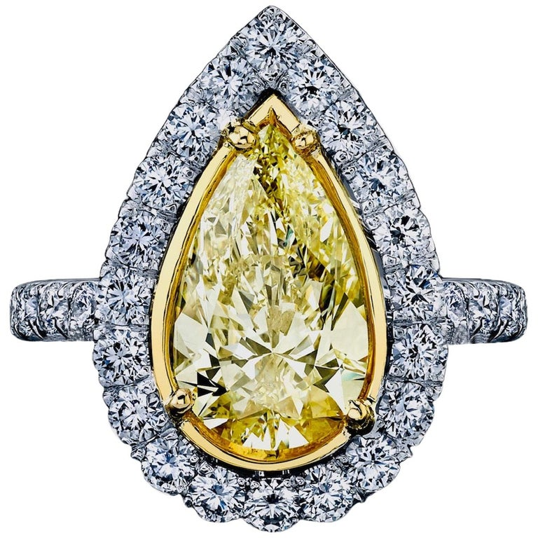GIA Certified 3.02 Carat Pear Shape Yellow Diamond Ring For Sale