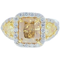 GIA Certified 3.03 Carat Fancy Yellow Diamond Cocktail Ring