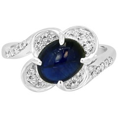 GIA Certified 3.04 Carat Blue Sapphire Cabochon Diamond Halo Gold Cocktail Ring