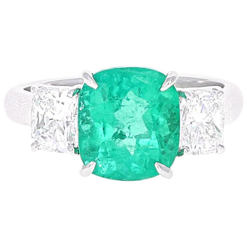 GIA Certified, 3.10 Carat Cushion Cut Emerald and Diamond Three-Stone Ring