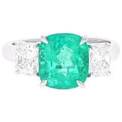 GIA Certified, 3.10 Carat Cushion Cut Emerald and Diamond Three-Stone Ring