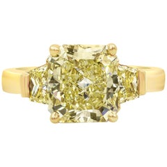 GIA Certified 3.10 Carat Radiant Cut Yellow Diamond Three-Stone Engagement Ring