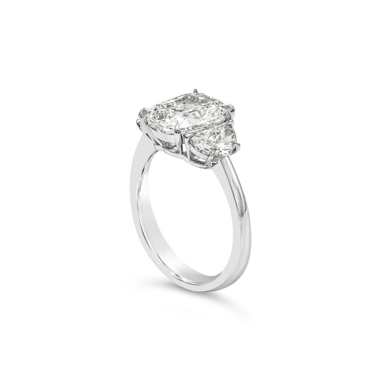 Contemporary GIA Certified 3.11 Carat Cushion Diamond Three-Stone Engagement Ring For Sale